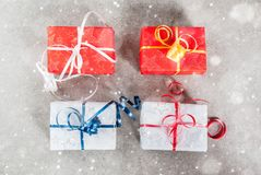Christmas background with gifts. Christmas background with decorated gifts. Gray background, snow effect, Top view copy space Stock Photos
