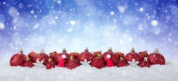 Christmas Background - Decorated Red Balls On Snow with snowflakes and stars.  Royalty Free Stock Photos
