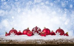 Christmas Background - Decorated Red Balls On Snow with snowflakesand stars on wooden desk. Christmas Background - Decorated Red Balls On Snow with snowflakes stock photos