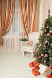Christmas background with decorated tree. In cozy interior in warm colors Stock Photography