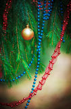 Christmas background with decoration bead on the fir branch Royalty Free Stock Photography