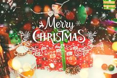 Christmas background with Christmas decoration with snow, stars, gifts, sparking and text Merry Christmas and Happy New Year stock image