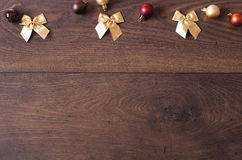 Christmas background with decorations. Christmas border design on the wooden background. Royalty Free Stock Photos