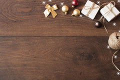 Christmas background with decorations. Christmas border design on the wooden background. Royalty Free Stock Photo