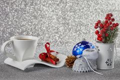 Christmas background with decorations, a cup with a saucer, a ca Royalty Free Stock Image