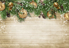 Christmas background with decorations and firtree on wooden boar Stock Photos