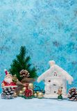Christmas background with Christmas decorations. Floral decorations. Blue background with a snow-white winter home. Christmas stock images