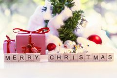 Christmas background with decorations gift box and and miniature royalty free stock photo
