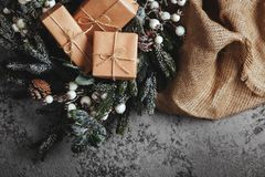 Christmas background with decorations and gift boxes on board stock image