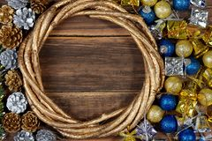 Christmas background with decorations and gift boxes on wooden b Stock Photos