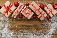 Christmas background with decorations and gift boxes. On wooden board Stock Photo