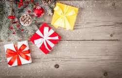 Christmas background with decorations and gift boxes on grunge wooden board. Top view stock images