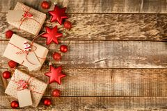 Christmas background with decorations and gift boxes on wooden board royalty free stock images