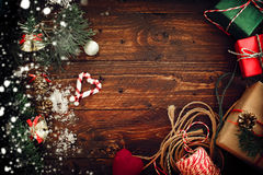 Christmas background with decorations and gift boxes on wooden board Royalty Free Stock Image