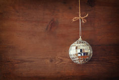 Christmas background with decorations hanging on a rope over wooden background. Stock Photo