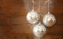 Christmas background with decorations hanging on a rope over wooden background. Royalty Free Stock Photos