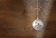 Christmas background with decorations hanging on a rope over wooden background. Stock Images