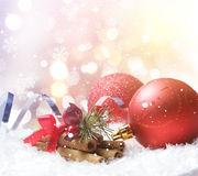 Christmas background of decorations nestled in snow Stock Photo