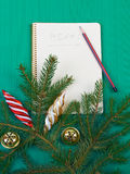 Christmas background. Christmas decorations and notebook on a green background Stock Photography