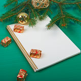 Christmas background. Christmas decorations and notebook on a green background Royalty Free Stock Images