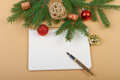 Christmas background. Christmas decorations and notebook on paper background Royalty Free Stock Images