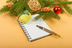 Christmas background. Christmas decorations and notebook on paper background Royalty Free Stock Photos