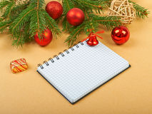 Christmas background. Christmas decorations and notebook on paper background Royalty Free Stock Image