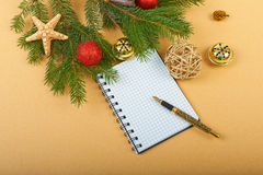 Christmas background. Christmas decorations and notebook on paper background Stock Photo