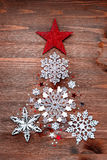 Christmas background with decorations in shape of fir tree Royalty Free Stock Photography