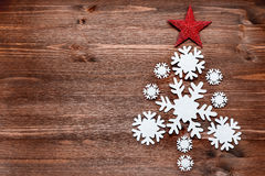 Christmas background with decorations in shape of fir tree Royalty Free Stock Photo