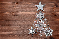 Christmas background with decorations in shape of fir tree Stock Photo