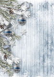 Christmas background with decorations and snow on wooden board. Beautiful Christmas background with snowflakes, balls, snow-covered branches for congratulations Stock Photos