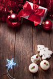 Christmas Background. Christmas decorations, sweets, present on a wood background Royalty Free Stock Photo
