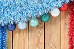 Christmas background with decorations on wooden board with copy space for text. New year theme for postcards. Wooden background royalty free stock photo