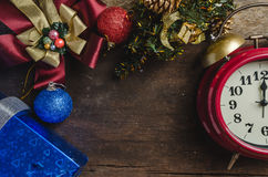 Christmas background with decorations on wooden panel Royalty Free Stock Image