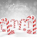 Christmas background with decorative baubles and candies on snow Royalty Free Stock Photo