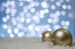 Christmas background. Decorative christmas background with decorations in snow. Blue blur background. Gold balls Royalty Free Stock Photos