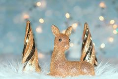 Christmas background with a deer. And Christmas trees Royalty Free Stock Photography