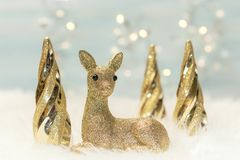 Christmas background with a deer. And Christmas trees Stock Photography