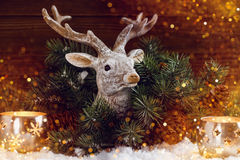 Christmas background with deer head decoration in shine lights Royalty Free Stock Photos