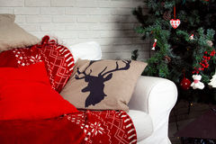 Christmas background with deer print on pillow Royalty Free Stock Photography