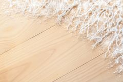 Diagonal wooden planks, white frosty branches in the top right, covered with snow and copy space. stock photo