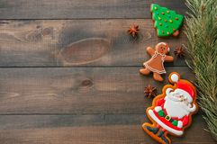 Christmas background. Different shapes of gingerbread cookies an royalty free stock image