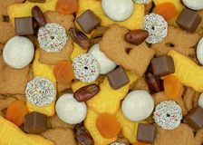 Christmas background from different sorts of Christmas cookies,. Sweets, dates and dried apricots View from above stock photo
