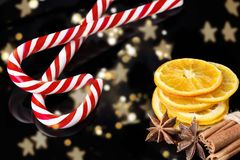 Christmas background with dried slice of orange, cinnamon stick. Candy cane Royalty Free Stock Photography