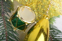 Christmas background with drums, green eve tree branch, golden new year Royalty Free Stock Images