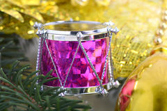Christmas background with drums, green eve tree branch, new year decoration Stock Image