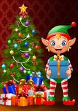 Christmas background with elf holding gift box Stock Photo