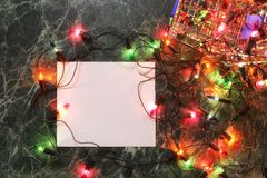 Christmas background blank paper and decoration with garland Royalty Free Stock Photo