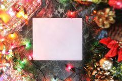 Christmas background blank paper and decoration with garland Stock Photo